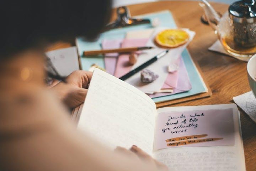 woman journaling in notebook