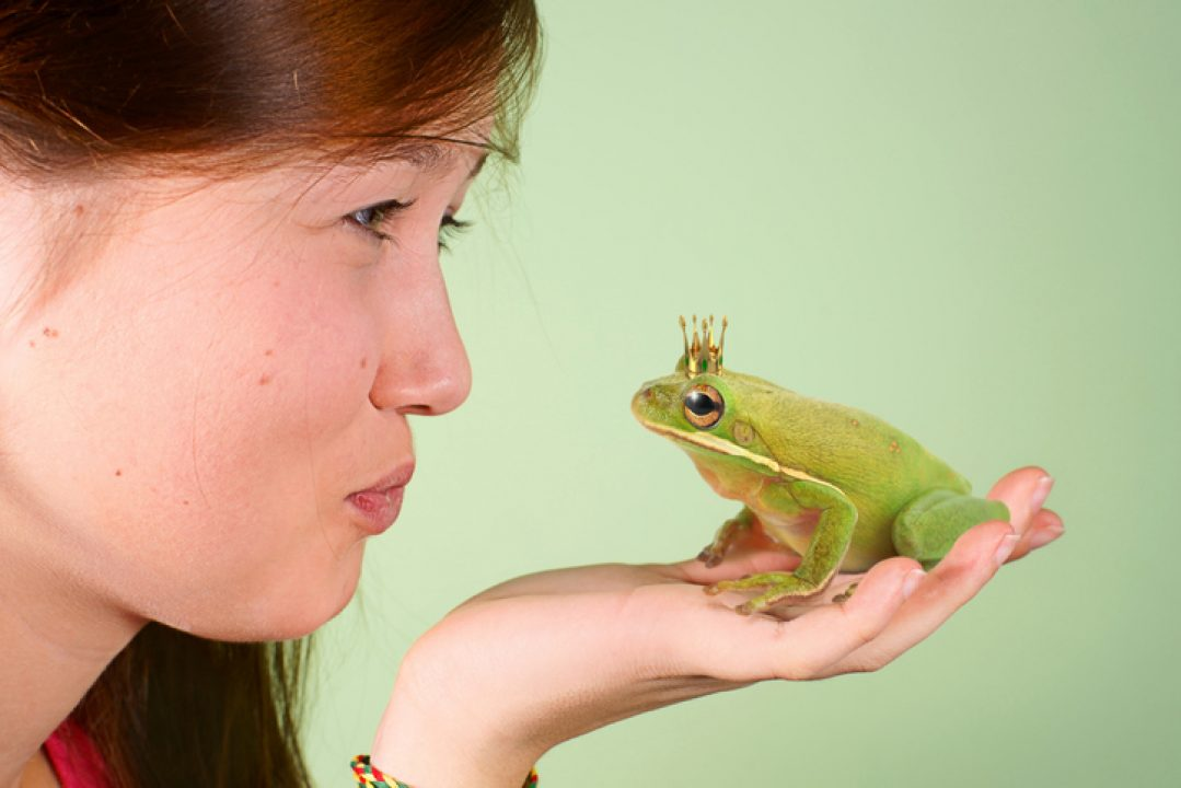 Woman kissing frog is humorously a nod to kambo ceremony, a wellness trend in 2021