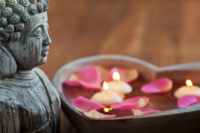buddha statue and flowers