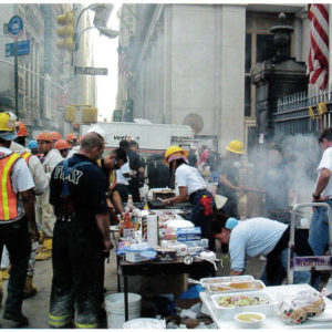 Volunteers barbecue food for rescue workers outside St. Paul's.