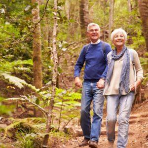 Mature couple walks in woods