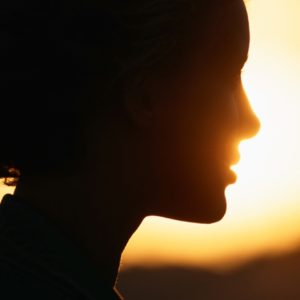 Woman silhouette with bright light