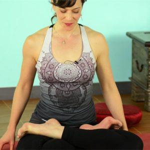 Woman in padmasana or lotus pose