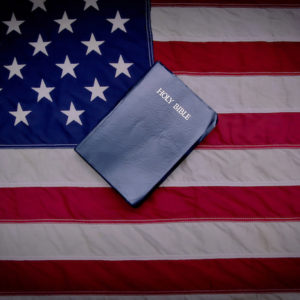 Bible lays on top of the American flag