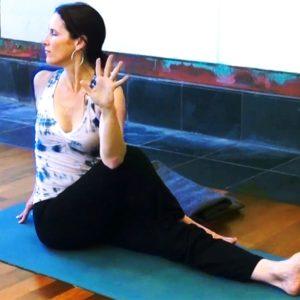Rebecca Snowball in twisting yoga pose