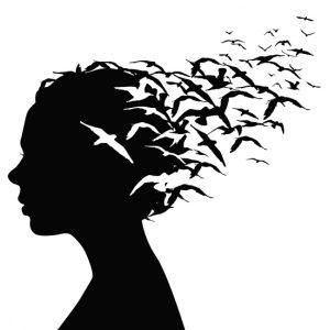 Image of birds flying away representing releasing pain.