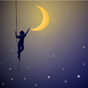Boy holding crescent moon