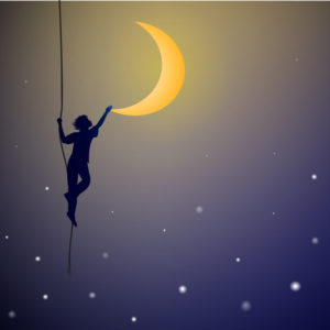 Boy holding crescent moon