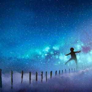 Boy balancing on sticks a starry night