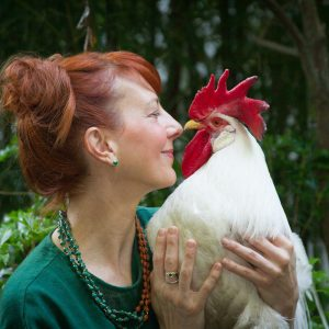 Woman with her rescue rooster pet