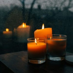 Candles and blanket on wood surface