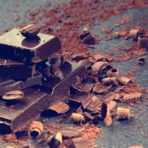 Dark chocolate bar and shavings with cacao beans