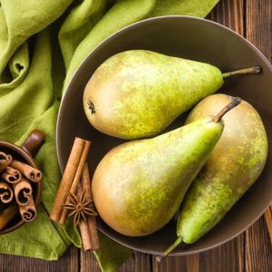 Pears and cinnamon on table
