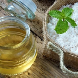 Coconut oil in glass jar with raw coconut