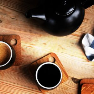 Coffee and tea on wood table