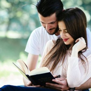 Couple reading book together