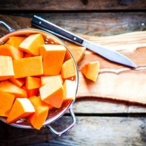 Cut pumpkin on wood surface