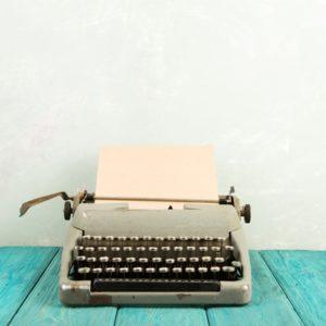 Typewriter on blue table