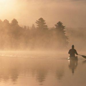 Man canoeing in boat