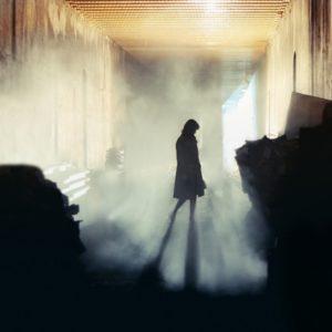 Woman in dark room