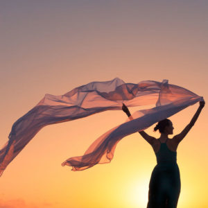 Woman holding silk in wind