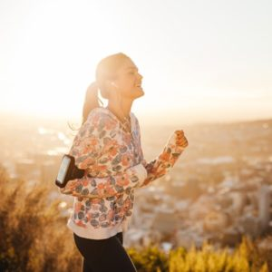 Woman listens to music on morning run