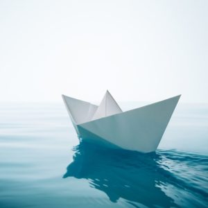 Paper boat floating on water