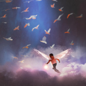 Flying boy in the clouds