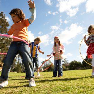 Kids hula hooping in park
