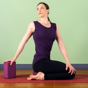 Woman in seated twist yoga pose