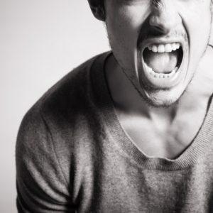 man yelling black and white