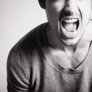man yelling black and white