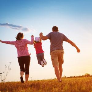 A happy family enjoys time outside
