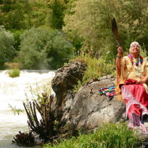Grandma Aggie on the Story Chair at Ti'lomikh Falls during the Takelma Salmon Ceremony in 2012.