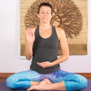 Meditation teacher in easy seat pose