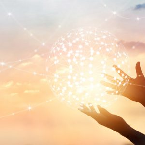 Hands reaching out with a healing circle of lights that extend out to the world.
