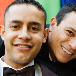 Happy gay couple in tuxedos