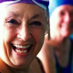 Happy older woman at pool