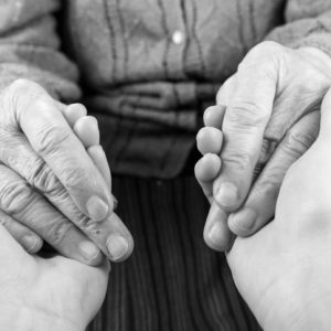 The helping hands of a caregiver