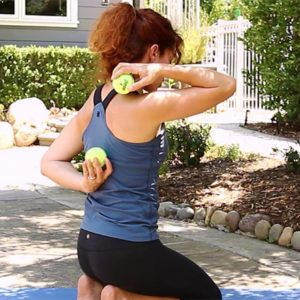 Image of woman using tennis balls to relieve back pain
