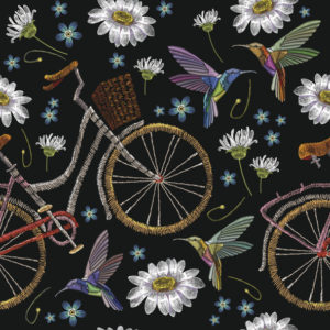 Embroidery of bicycles, chamomile flowers, and humming birds in a seamless pattern.