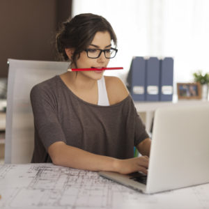 A woman works at her desk