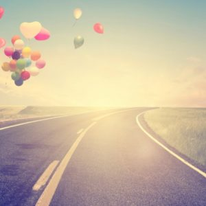 Heart-shaped balloons and open road