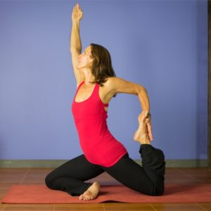 Woman in hip-opening yoga pose