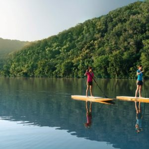 Two women paddleboarding at Lake Austin Spa Resort
