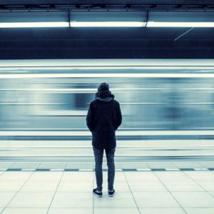 Man alone at subway station