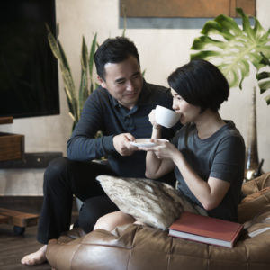 Man offering coffee to his wife