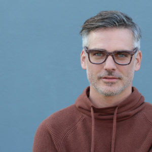 Attractive man with glasses illustrates the concept of mindful sexuality
