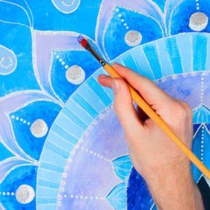 Painting a blue mandala design