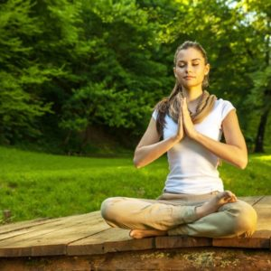 Woman meditating in nature